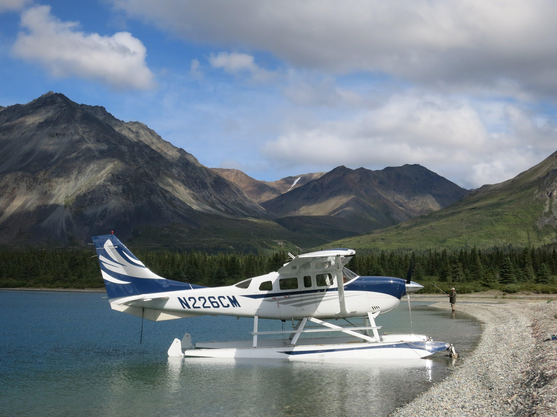 Cessna 206 on Wipline 3450 Floats on a Mountain Lake