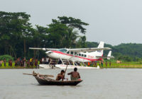 Fishermen in Front of a Caravan Seaplane in Bangladesh - Copyright MAF