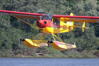 Aviat Husky A1C on Wipline 2100 Floats in Flight