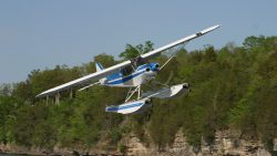 Piper Cub on Wipline 2100 Floats in Flight