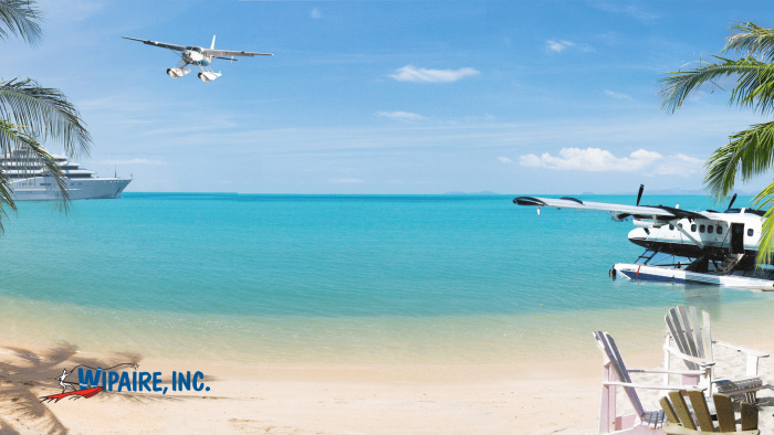 Meeting background with a Grand Caravan and Twin Otter at the beach.