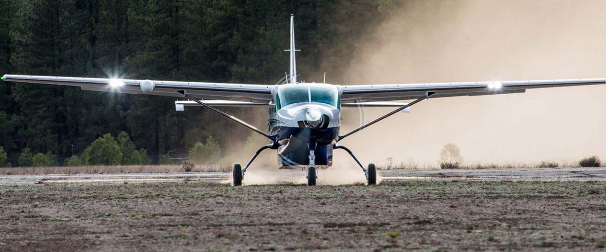 Cessna Caravan landing on a dirt strip